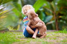 Kids Play With Puppy. Children...