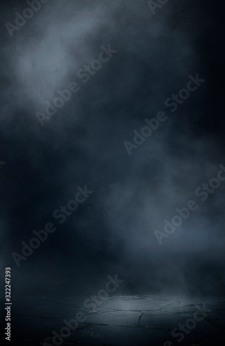 Fototapeta Wet asphalt, reflection of neon lights, a searchlight, smoke. Abstract light in a dark empty street with smoke, smog. Dark background scene of empty street, night view, night city. obraz