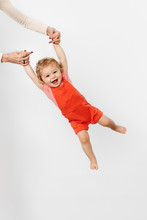 Happy Baby Flying Against White Wall