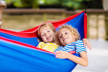 Boy In Hammock. Kids Play In S...