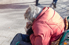 Senior Man Sitting On A Wheelchair Outdoors In Winter. An Old Beggar Asks For Money To Donate Help. Social Problems.