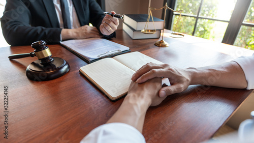 Photo Male Notary lawyer or judge consult or discussing contract papers with Businessm