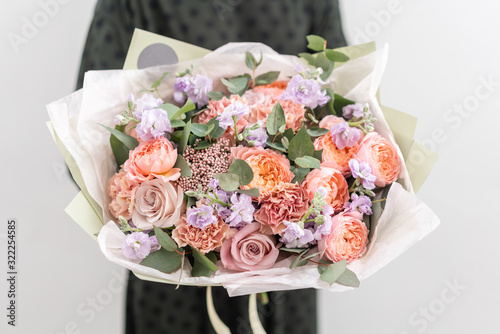 Beautiful bouquet of mixed flowers in womans hands. the work of the florist at a flower shop. Handsome fresh bouquet. Flowers delivery © malkovkosta