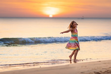 Child Playing On Ocean Beach. ...