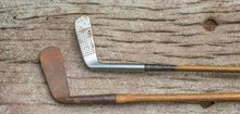 Two Vintage Golf Clubs With Hickory Shafts Isolated