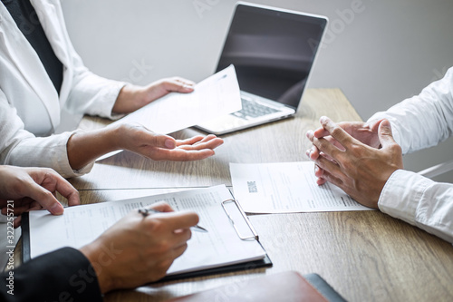 Fotografija Employer or committee holding reading a resume with talking during about his pro