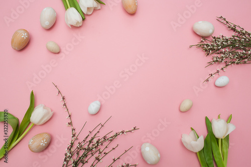 Fototapety, obrazy: Creative layout With white tulips flowers and Easter eggs on a pink background. holiday concept. Flat lay, top view.