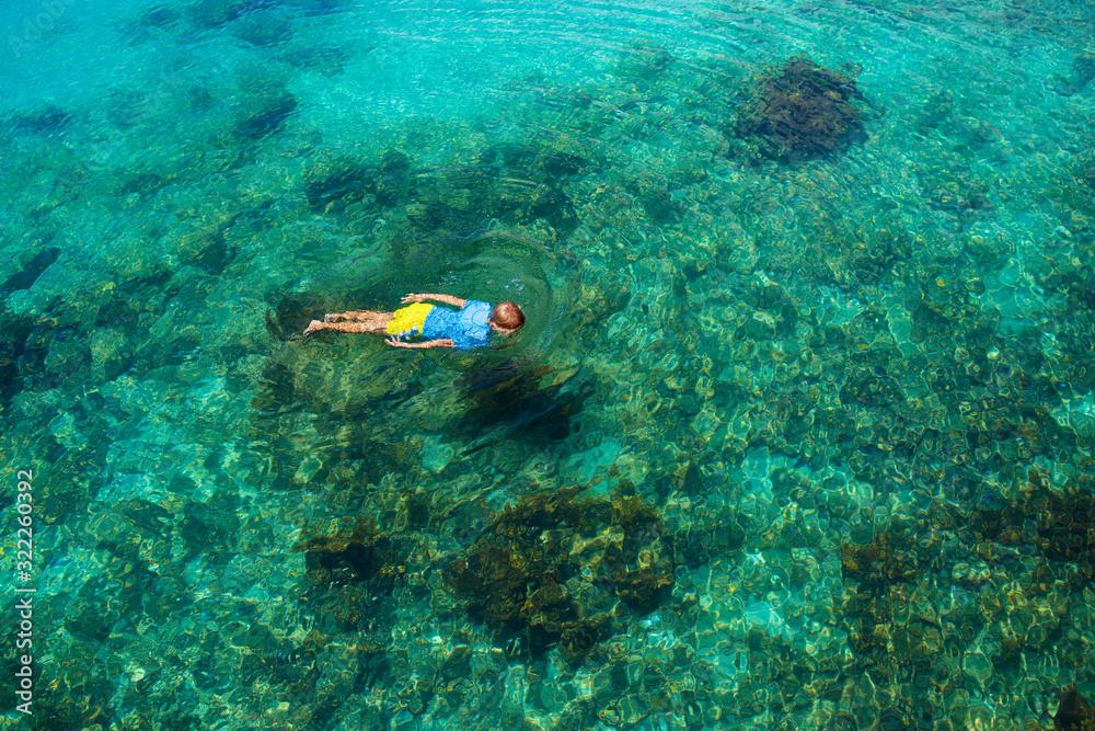 Fototapeta Kids snorkel. Children snorkeling in tropical sea.
