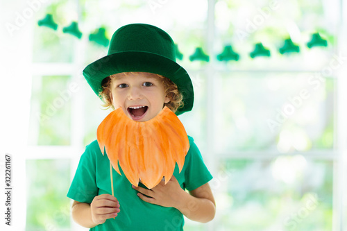 Canvas Print Kids celebrate St Patrick Day. Irish holiday.