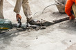 canvas print picture - Construction worker using jackhammer drilling concrete surface