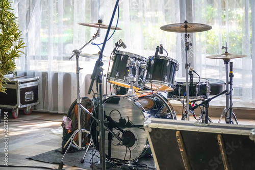 Valokuvatapetti Drum set in a cafe or restaurant before a corporate party or wedding on the back