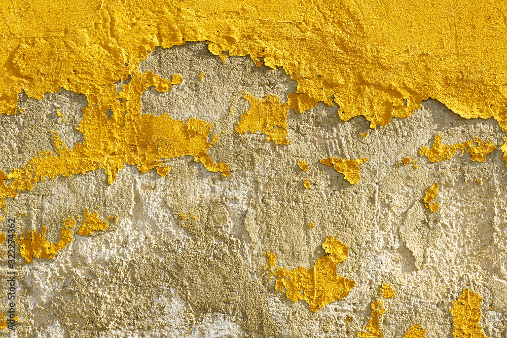 Old weathered painted yellow color peeling wall grunge background