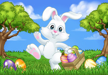 Easter Bunny Rabbit Cartoon Character Holding A Basket Full Of Painted Easter Eggs In A Field Of Grass.