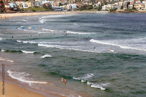 A group of people are swimming in the ocean at the Bondy beach in Australia on s Canvas Print