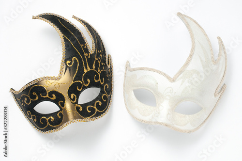 Fototapeta Two black and white theater or mardi gras venetian masks on white background obraz