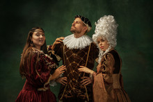 Love Games Pay Attention. Portrait Of Medieval Young People In Vintage Clothing On Dark Background. Models As A Duke And Duchess, Princess, Royal Persons. Concept Of Comparison Of Eras, Modern