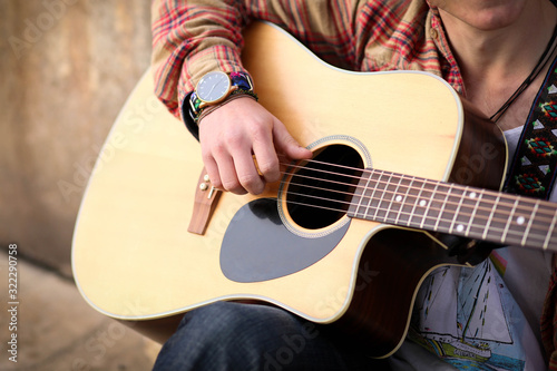 Close up image of man strumming guitar Slika na platnu