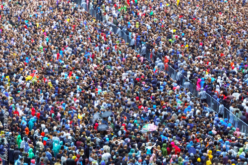Fototapeta large crowd of people view from above selective focus. defocus crowd of people on city street, top view obraz