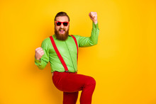 Portrait Of Cheerful Crazy Delighted Man Fun On Spring Holiday Win Competition Lottery Raise Fists Scream Yeah Wear Suspenders Pants Isolated Over Yellow Color Background