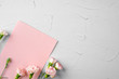 canvas print picture Top view of a pink paper letter and flowers with copy space