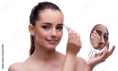 Woman in beauty concept applying make up using cosmetics Wallpaper Mural