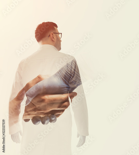 Photographie Double exposure image with doctor and helping hand