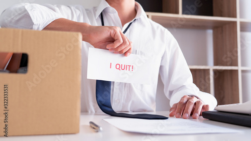 Fotografering Businessman holding with I quit words card letter, resign employee Change of job concept