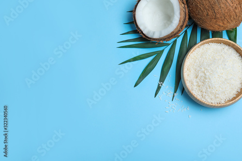 Fotografie, Obraz Flat lay composition with fresh coconut flakes on light blue background