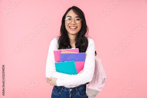 Stampa su Tela Image of young asian student girl wearing eyeglasses holding folders
