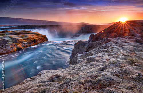 Obraz Incredible frosty morning and sunrise at the most famous place of Golden Ring Of Iceland. Godafoss waterfall near Akureyri in the Icelandic highlands, Europe. Popular tourist attraction. Postcard. - fototapety do salonu