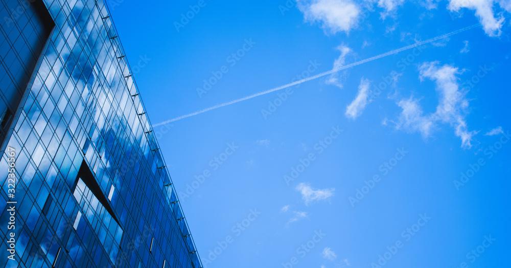 Fototapeta skyscraper with blue sky and clouds