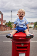 Crying Toddler Sitting On Postbox