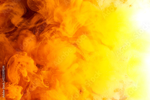 Abstract colorful yellow orange fog background, vibrant puffs of smoke and peach clouds - 322359534
