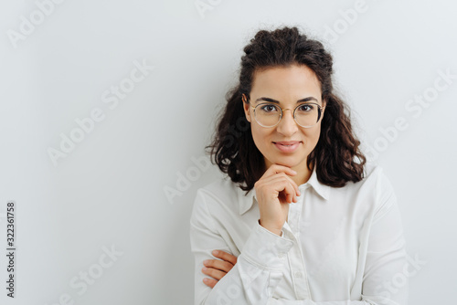 Young woman with an amused thoughtful smile Wallpaper Mural