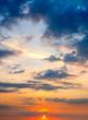Sun set. The sun's rays illuminate the clouds.