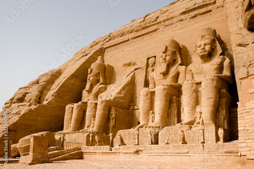 Fototapeta Huge statues of Egyptian King Ramses II seated at the entrance to the Great Temp
