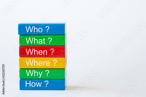 Fotografie, Obraz The words: Who, What, When, Where, Why and How are written on colorful blocks