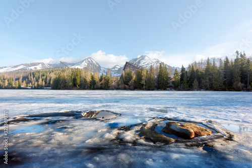 Fototapeta Mountain lake Strbske pleso (Strbske lake) in spring time. High Tatras national park, Slovakia. Landscape photography obraz