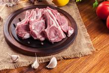 Raw Fresh Lamb Chops On Wooden Cutting Board