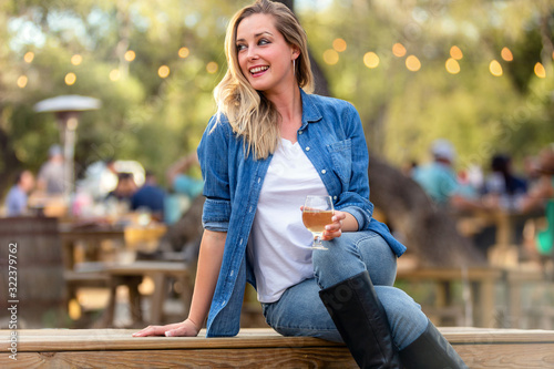 Lifestyle portrait of beautiful woman at a beer and cider music festival, with l Fototapeta