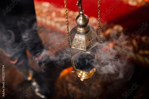 A priest's censer hangs on an old wall in the Orthodox Church Fototapeta