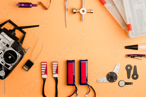 Drone workshop table, with drone parts, and tools on the orange worktable Wallpaper Mural