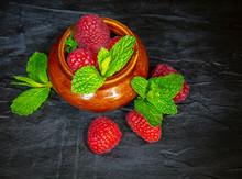 Fresh Ripe Raspberries And Min...