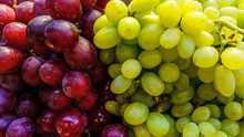 Piles Of Red And Green Grapes ...