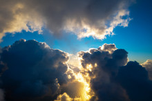 Parting Clouds Reveal Blue Skies
