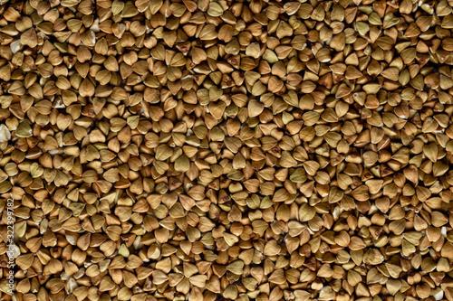 Grains of raw green buckwheat. Background flat-lay #322399782