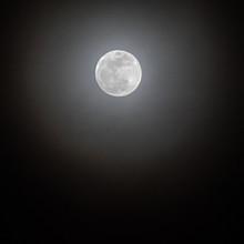 Hazy Full Moon In A Black Sky
