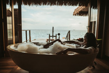 Woman Relaxing In Bathtub With...