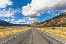 New Zealand, Grey District, Inchbonnie, Clouds Over Empty State Highway 73 With Mountains In Background