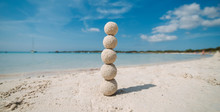 Sand Balls Stacked On A Column...